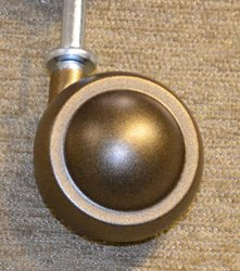 #9 Antique Metal Tread Caster (Carpet or rug use).jpg